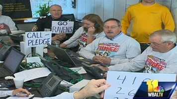 Volunteers take phone calls for donations throughout the morning as the plunge continues.