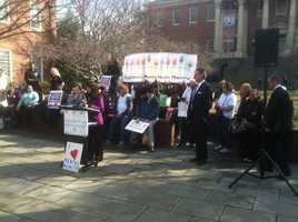A group rallies in support of better mental health care laws.