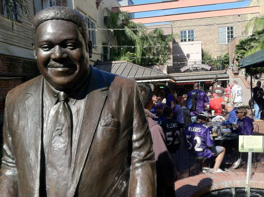 Fats Domino with some Ravens fans in the background having a Super Sunday breakfast along Bourbon Street in New Orleans