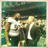 Gilbert talks to defensive end Arthur Jones.
