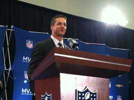 Coach John Harbaugh is all smiles the day after winning the Super Bowl.