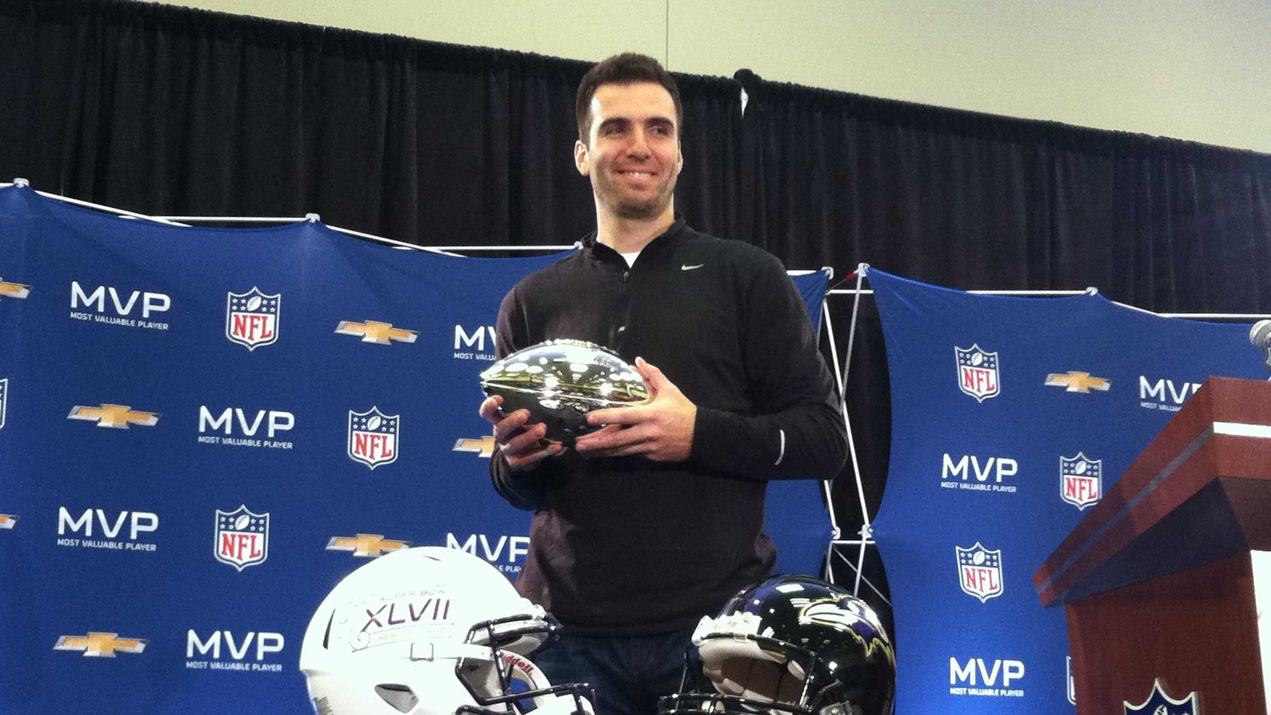 Super Bowl MVP Joe Flacco smiles about the win at the day-after press conference.