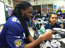 Torrey Smith with students at Chase Elementary.