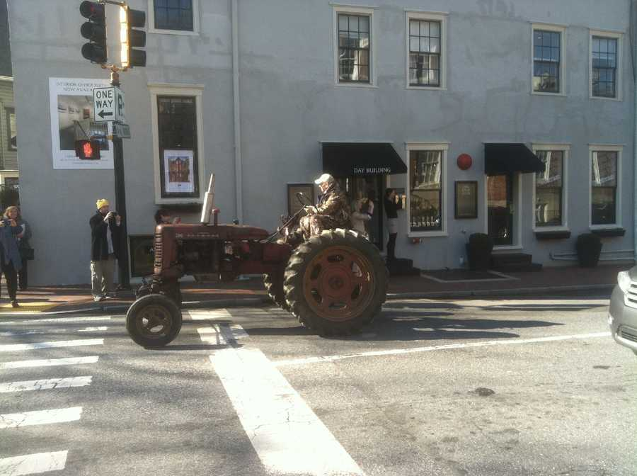 A tractorcade of farmers took to the streets in Annapolis Tuesday to protest a state law they claim devalues their property and takes away their right to sell farmland to developers.