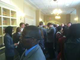 A crowd gathers outside the death penalty hearing room.