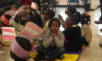 Volunteers were scheduled to read to various children at the school throughout the day.