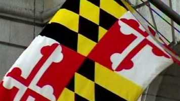 """State Flag: The design is taken from the """"escutcheon"""" or """"shield,"""" in the first Lord Baltimore's Seal, dating from the 1630s. Black and gold quarters are the arms of Lord Baltimore's family, the Calverts. Red and white quarters are those of his mother's family, the Crosslands.-- Maryland Tourism"""