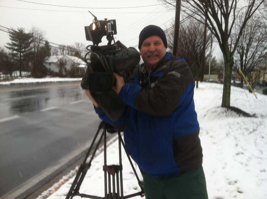 11 News photographer Tom Culp gets ready for Barry's liveshot.