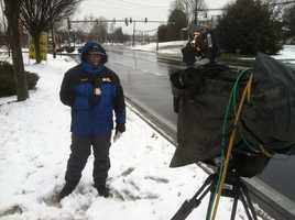 11 News reporter Barry Simms gets ready for his noon liveshot in Ellicott City, Howard County.