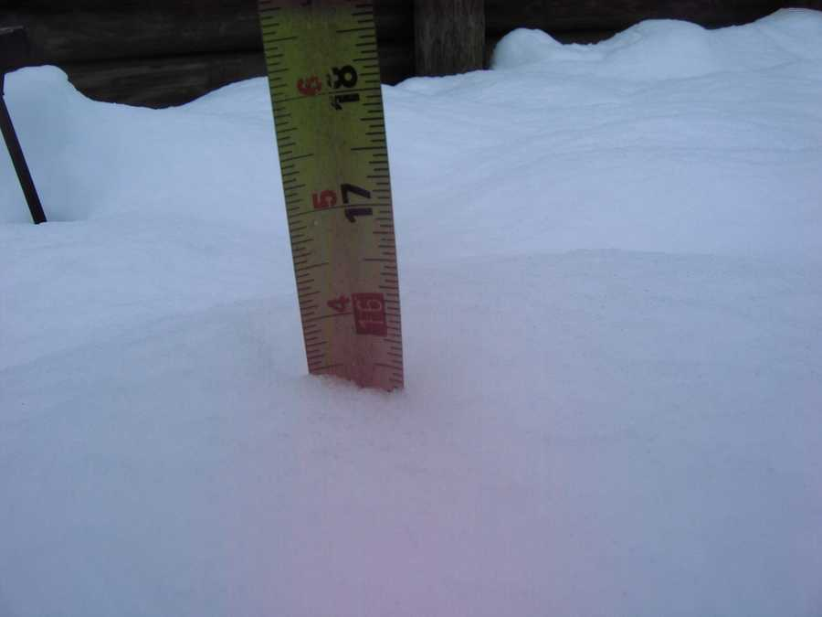 Hancock resident Kenneth Farley measures more than a foot of snow by noon Wednesday.