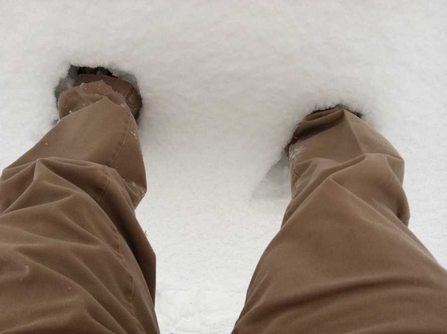 Scott Wykoff measures the accumulation in feet -- get it?? -- in Greenbrier State Park along Route 40 between Frederick and Hagerstown.