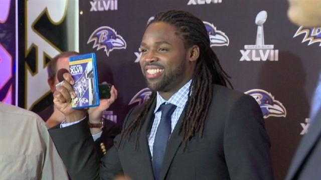 The event was held at the Modell Performing Arts Center at The Lyric. Here, Torrey Smith shows off his copy of the DVD.