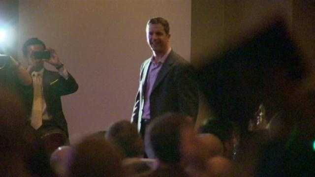 Harbaugh smiles at fans inside the event.