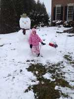 Brooke Minor shows off her snowman and his companion.