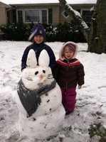 Brianna and Madison Maybury, of Denton, create an Easter snow bunny.