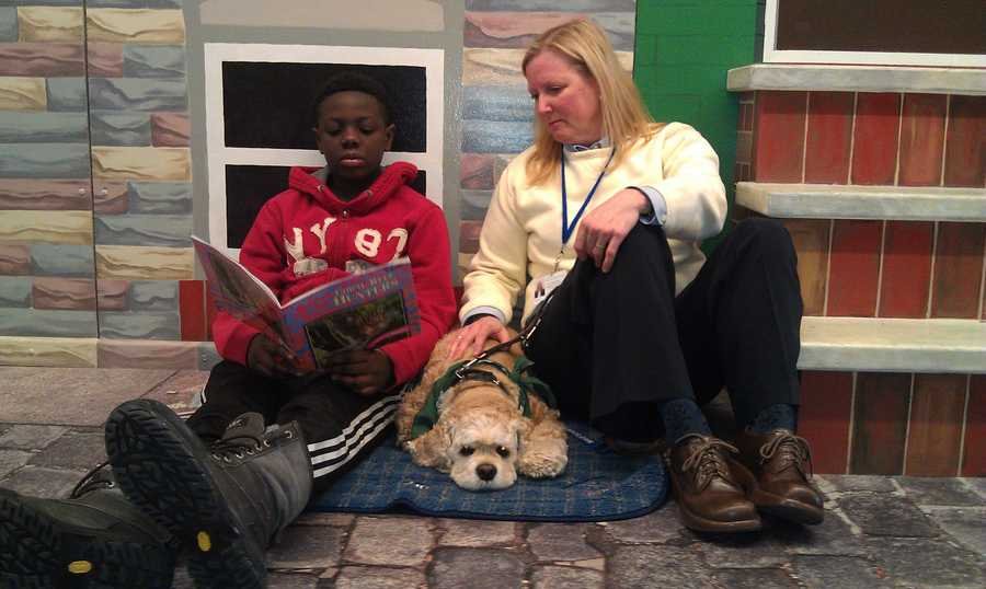 A boy named Wyleek, a fourth-grader who is on short-term placement at the Children's Guild, reads to Gabby in a hallway of the school.Read the story.