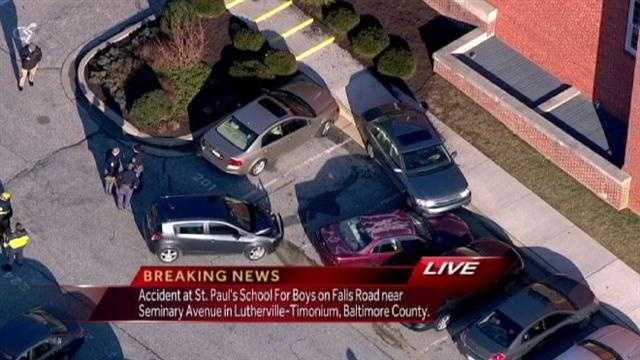 A car crashes into several other cars at a private school in Baltimore County.
