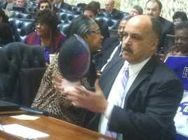 Baltimore City Delegate Curt Anderson plays with a football before Cass and Smith show up.