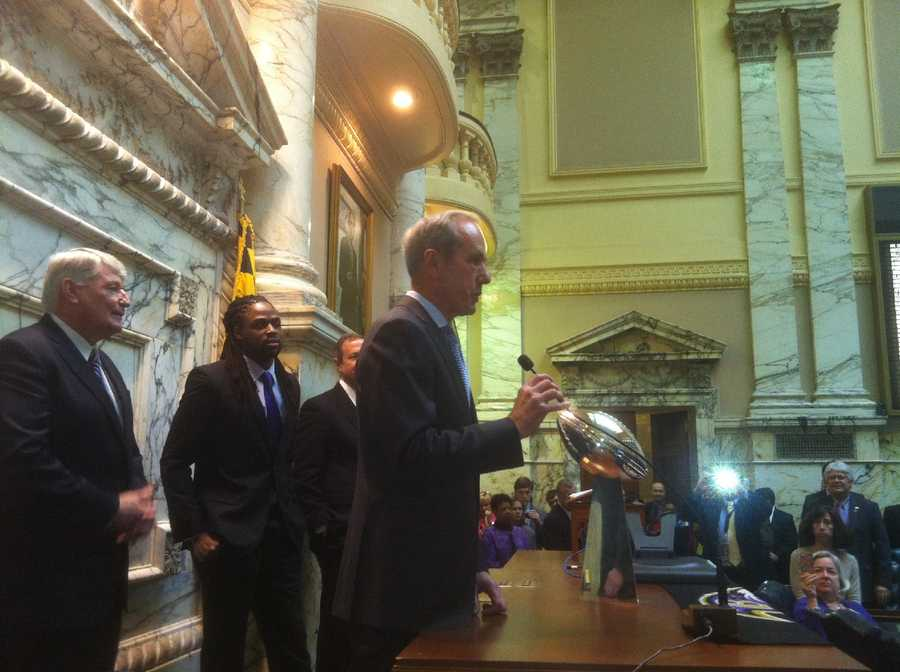 March 28: Ravens President Dick Cass talks with members of the House of Delegates as he and wide receiver Torrey Smith show off the Lombardi Trophy.