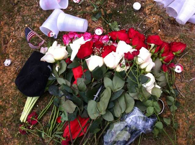 Relatives and friends mark the crash scene with flowers in remembrance of those who died.