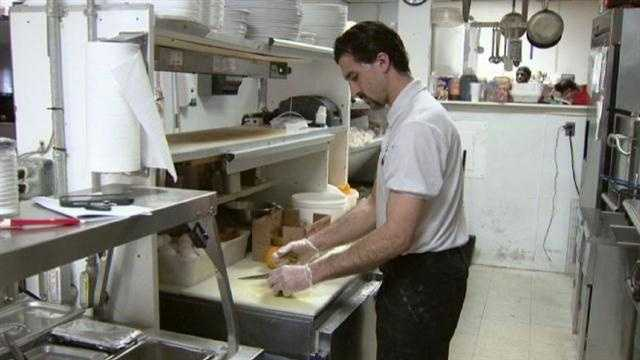 Mikie's line cook Michael Ourand prepares meals for a normal day at the restaurant.