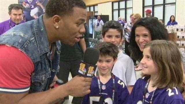 Ray Rice takes the 11 News microphone to talk to some kids at the event.
