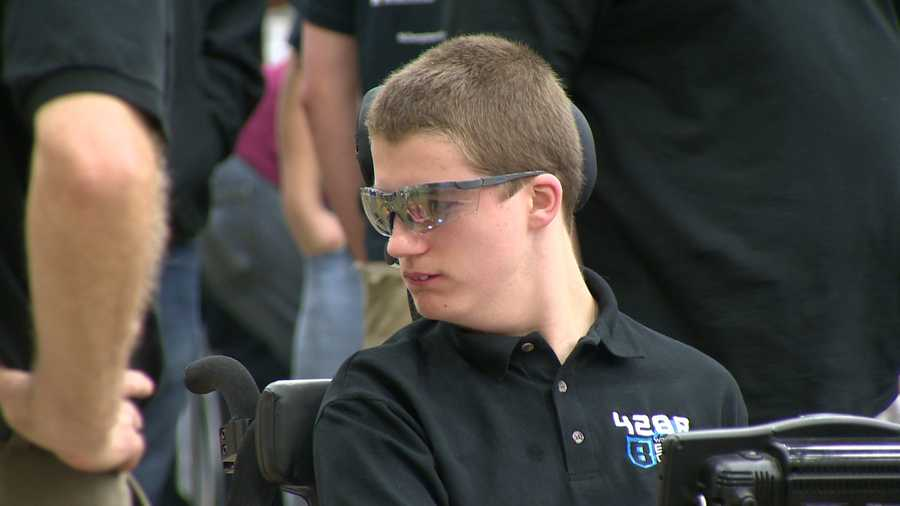 But as a straight-A student, he helped program the team's robot and is a shooter in the competition.