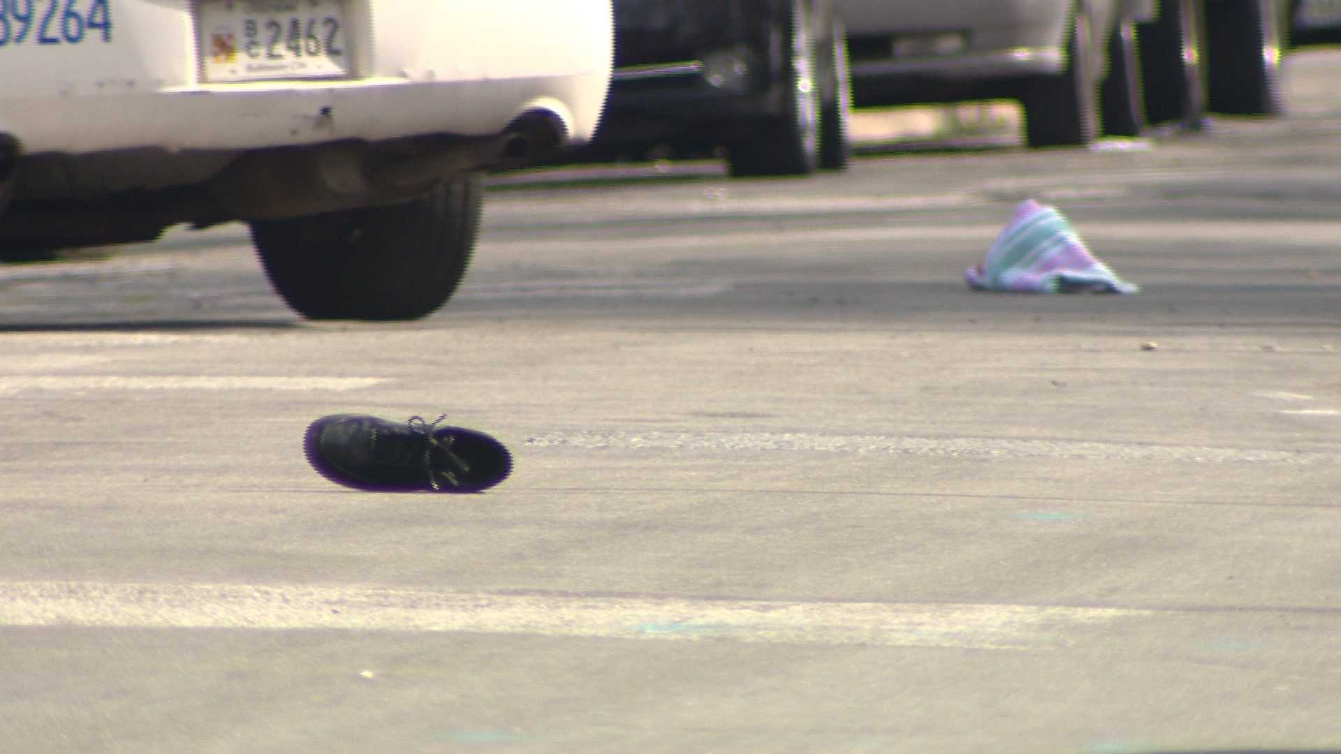 A shoe is left in the street at the scene where a 16-year-old boy was shot Sunday.
