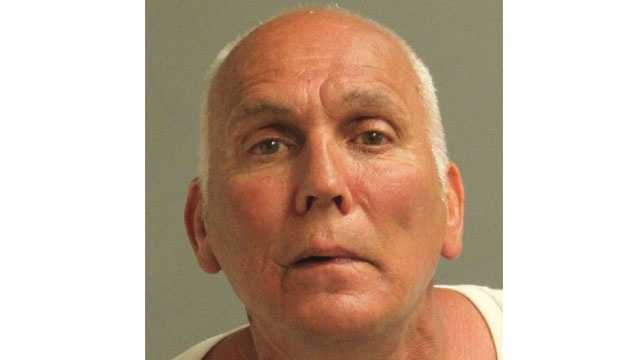 Police say 59-year-old Ronald Smith was arrested and charged in connection with making bomb threats.