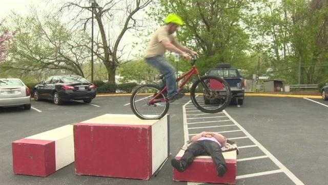 Matt Gilman practices his trick biking moves.