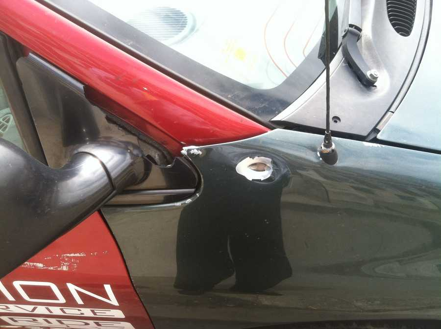 Bullet holes found in a taxi sedan nearby.