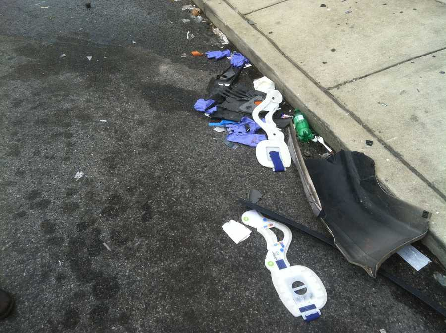 Medical debris is left on the street after the shooting.