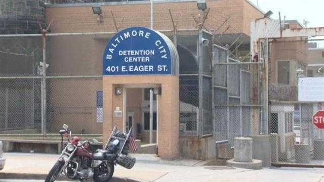 Dozens charged in prison bribery, sex scheme