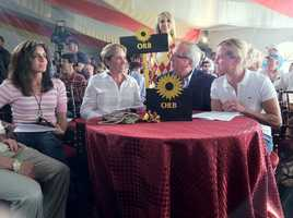 Orb trainer Shug McGaughey, right, and the Orb contingent await the post position draw.
