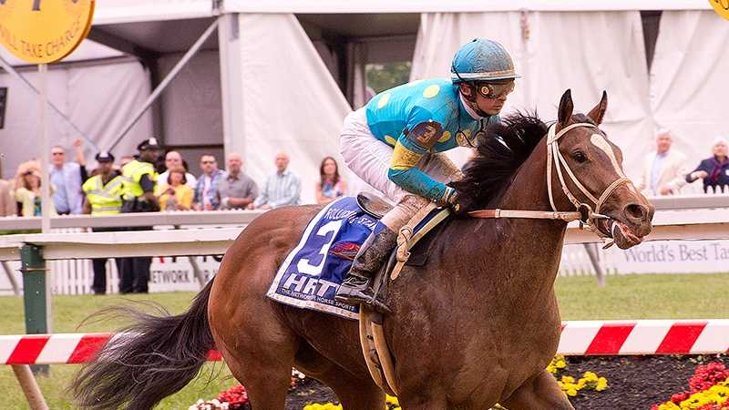 Debt Ceiling closes from off the pace to capture the $100,000 Rollicking Stakes for 2-year-olds Saturday at Pimlico Race Course.