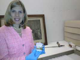 The Maryland Historical Society Chief Curator Alexandra Deutsch shows off an artifact.