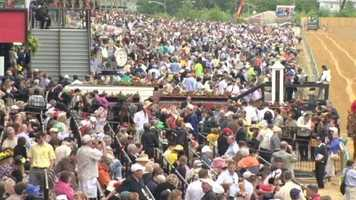 Race organizers say this year's event brought 117,000 people to Pimlico, the fourth largest crowd on record for the Preakness.