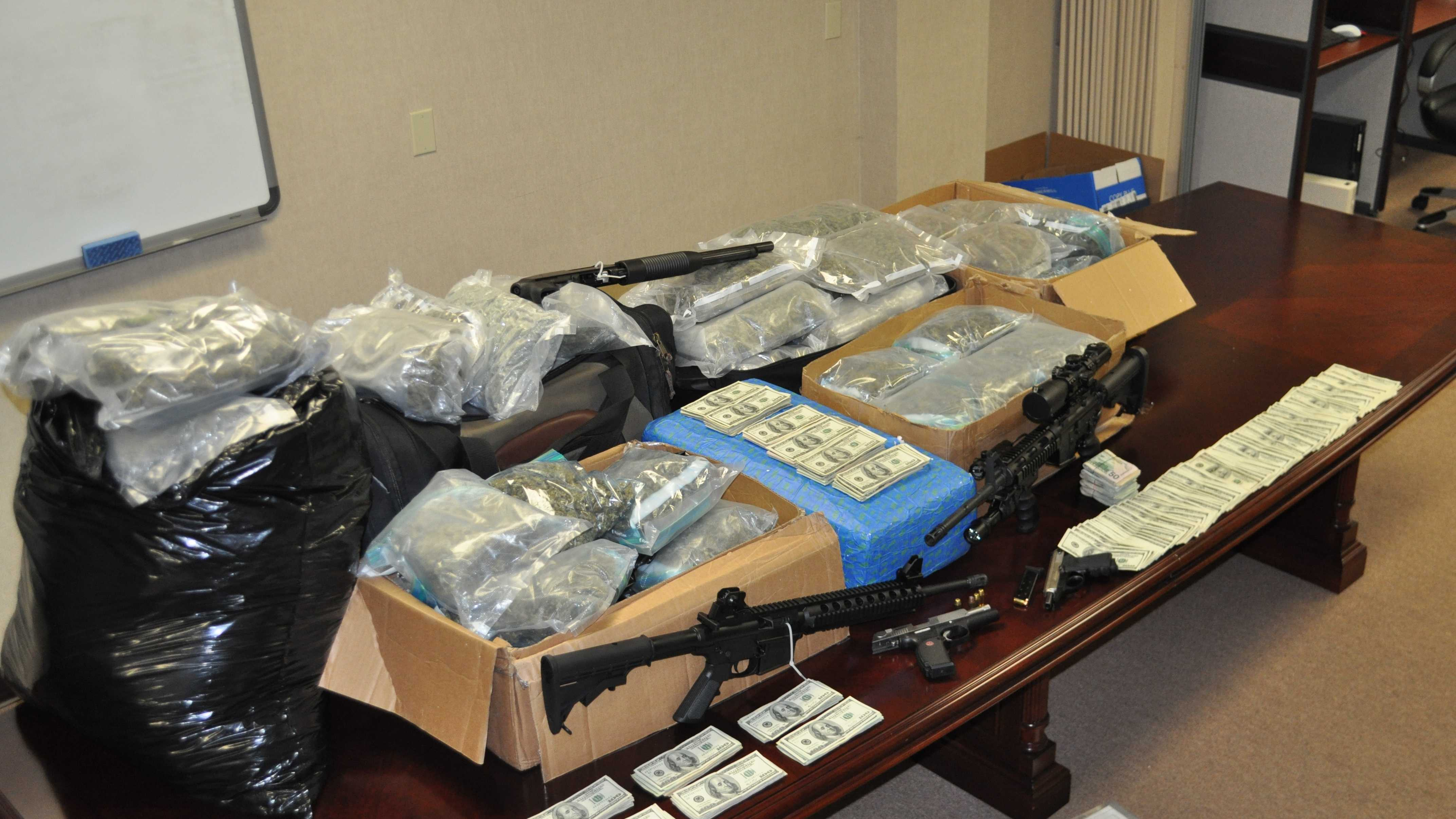 The Harford County Sheriff's Office says after a two-year investigation into a smuggling operation, it seized 140 pounds of marijuana, 20 guns, 14 vehicles and more than $140,000 in cash.