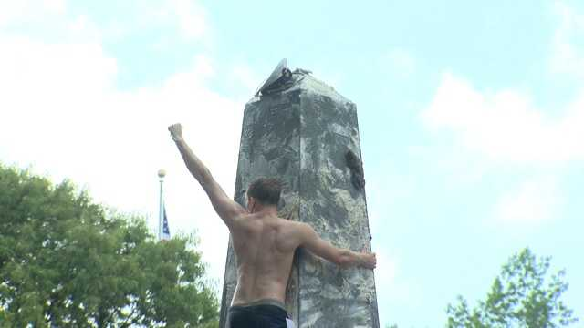 This year, the plebe to reach the top was Midshipman Patrick Lien, of Orlando, who did so in just under an hour and 43 minutes.