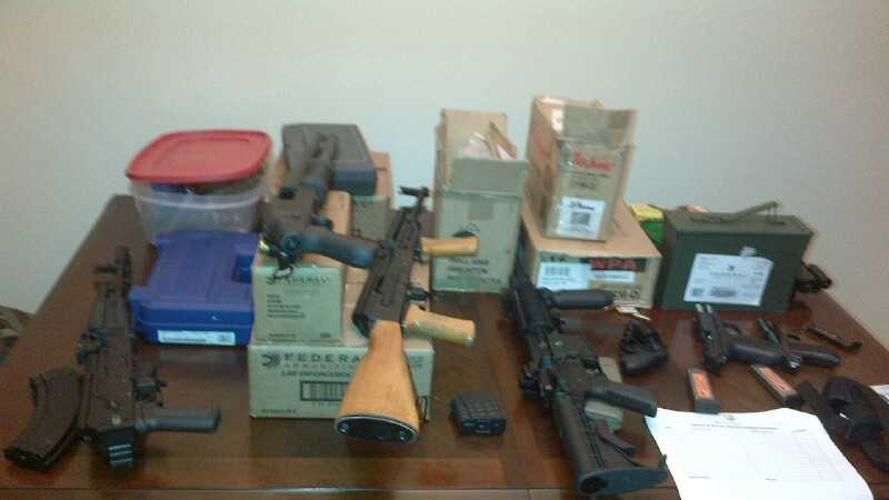 Police say they found this stash of guns and drugs during a raid on a southeast Baltimore home.