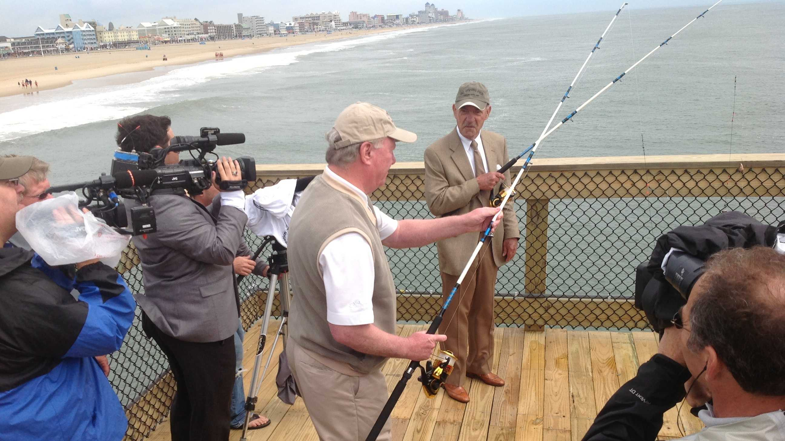 Ocean City Mayor Rick Meehan casts the first line off the restored fishing pier that was damaged during Hurricane Sandy.