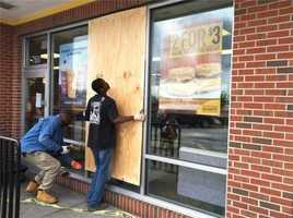 A nearby McDonald's repairs its broken window after the blast.
