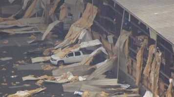 The explosion and fire severely damaged a warehouse that was about 50-60 yards away.