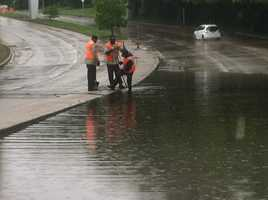 Standing water closes a section of Northern Parkway near McLean Boulevard in Baltimore before noon Thursday.