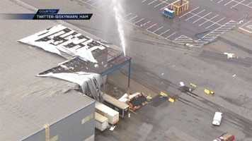 A building is damaged due to strong storms and possible tornadoes.