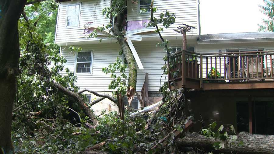 A woman living there told 11 News she was in the bed in her bedroom when the tree came crashing through the wall, collapsing debris on top of her.