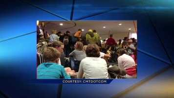 A traveler at BWI tweets a photo of people packed together in the baggage claim area and away from the windows after the airport told people to hunker down due to a possible tornado.