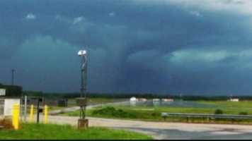 A BWI firefighter, who is also a meteorologist, takes a photo of what appears to be a funnel cloud over the airport.