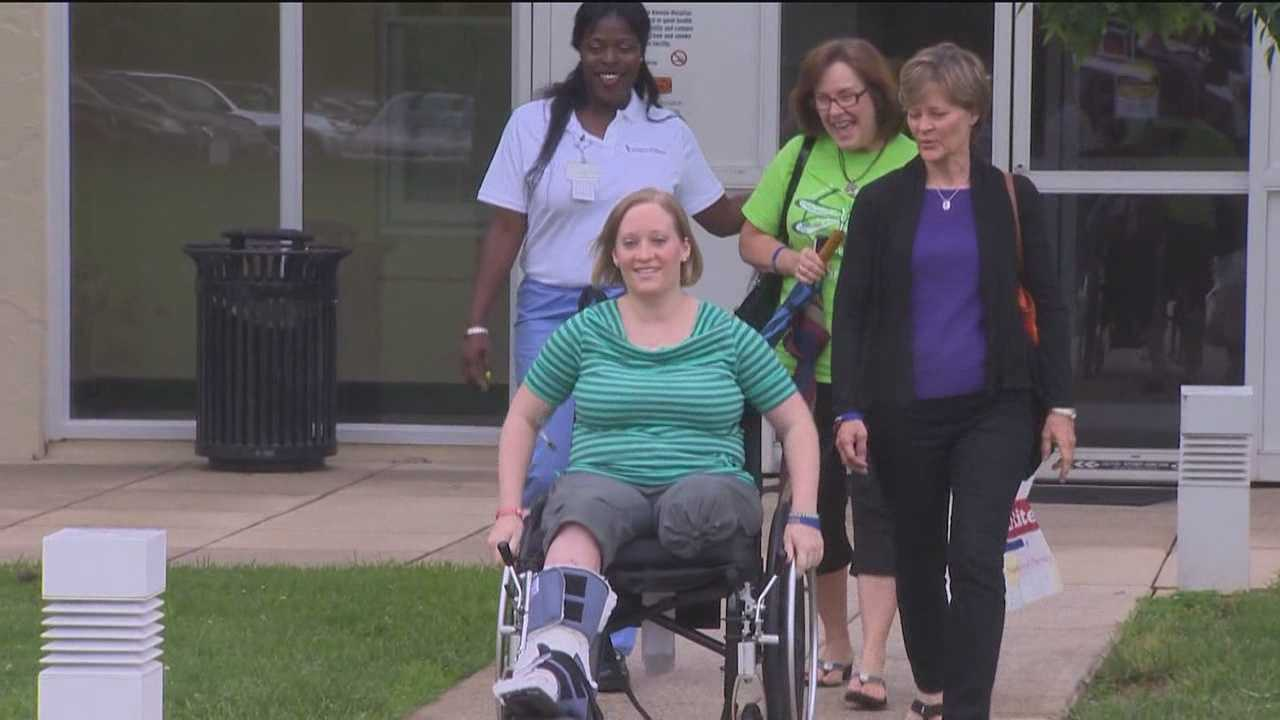 The Towson teacher injured in the Boston Marathon explosions returns home for the first time since the bombings.