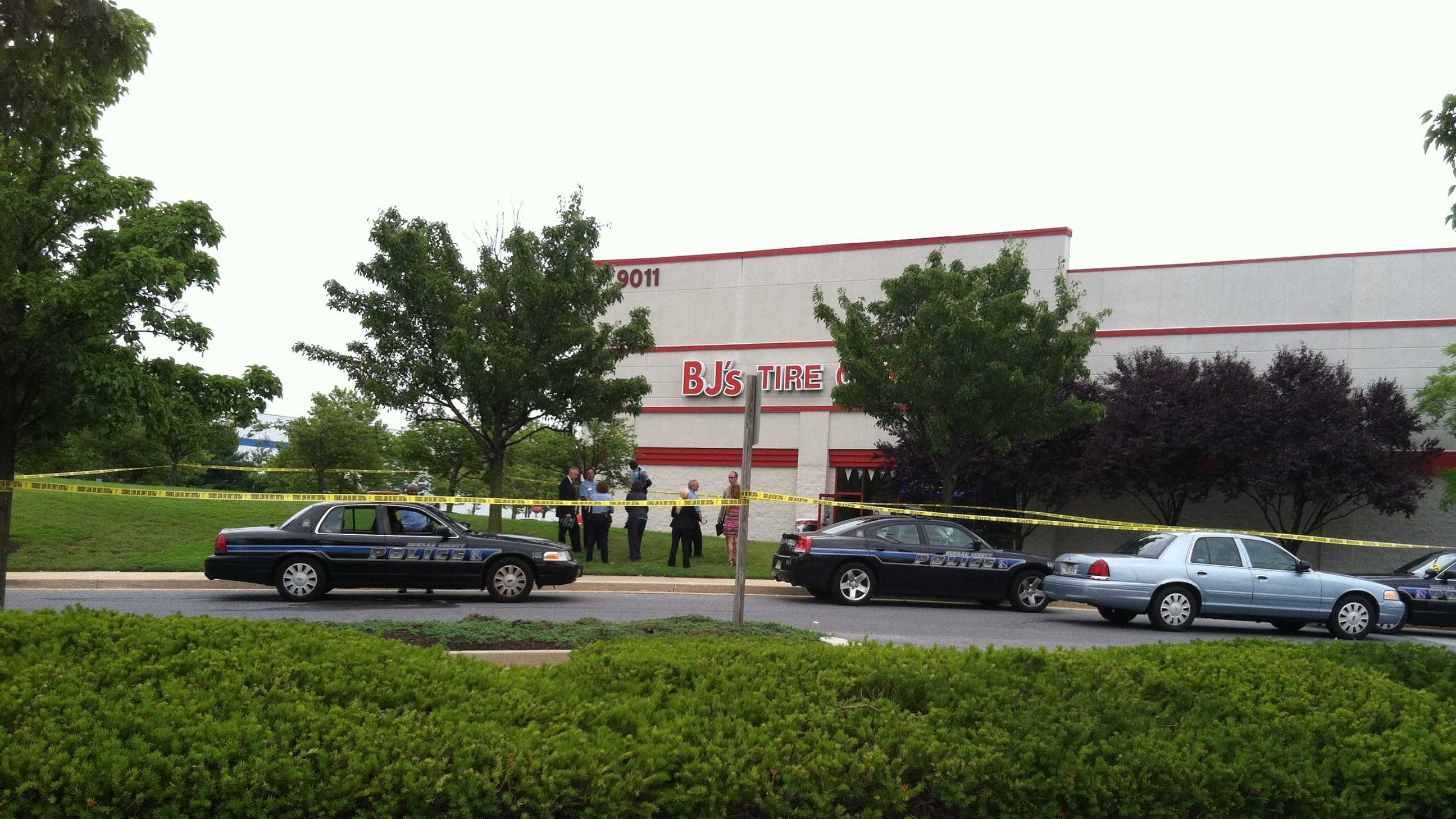 Police in Howard County investigate a shooting involving one of their own and a knife-weilding man at a BJ's store in Columbia.